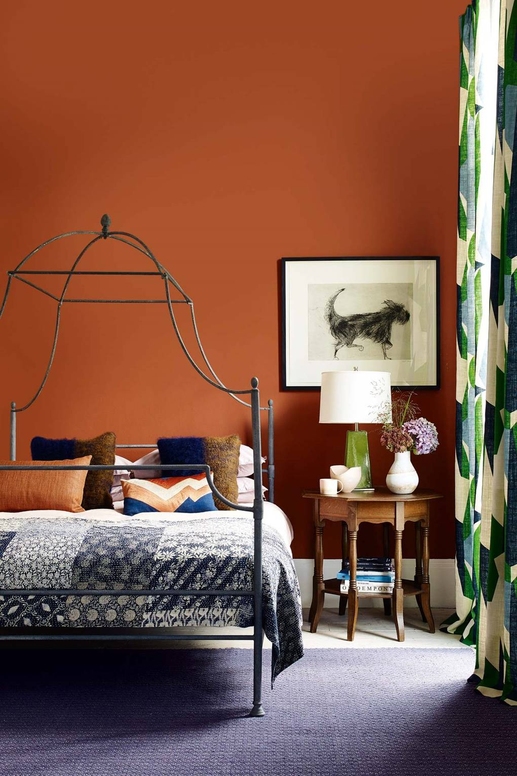 12 Dark Bedroom Ideas for a Cozy and Dramatic Look featured by top US lifestyle blog, Dreaming Loud: Terracota bedroom idea | Dark Bedroom Ideas by popular Michigan lifestyle blog, Dreaming Loud: image of a bedroom with terra cotta walls.