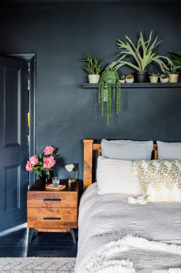 12 Dark Bedroom Ideas for a Cozy and Dramatic Look featured by top US lifestyle blog, Dreaming Loud: Total Blue Bedroom Idea | Dark Bedroom Ideas by popular Michigan lifestyle blog, Dreaming Loud: image of a bedroom with blue walls and a blue wood floor.