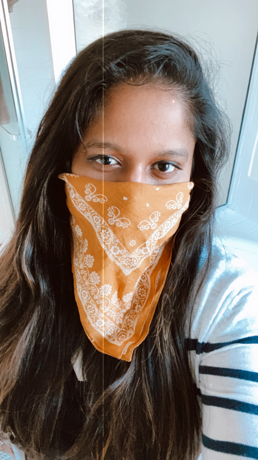 Wear Cloth masks to avoid spreading Corona Virus; COVID-19: How the VIRUS SPREADS and How to PROTECT YOURSELF AND OTHERS featured by top US fashion blog, Dreaming Loud picture of a women | Covid 19 survival tips and tricks by popular Maryland lifestyle blog, Dreaming Loud: image of a woman with and orange bandana tied around her face.