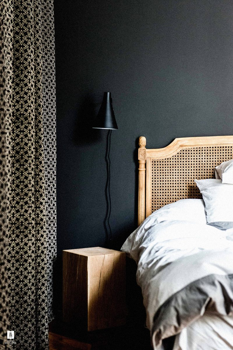 12 Dark Bedroom Ideas for a Cozy and Dramatic Look featured by top US lifestyle blog, Dreaming Loud: black bedroom with cane bed frame