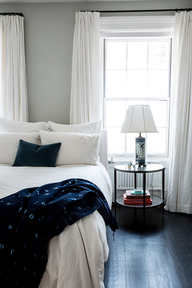 12 Dark Bedroom Ideas for a Cozy and Dramatic Look featured by top US lifestyle blog, Dreaming Loud: black floor bedroom ideas | Dark Bedroom Ideas by popular Michigan lifestyle blog, Dreaming Loud: image of a bedroom with black wood floors.