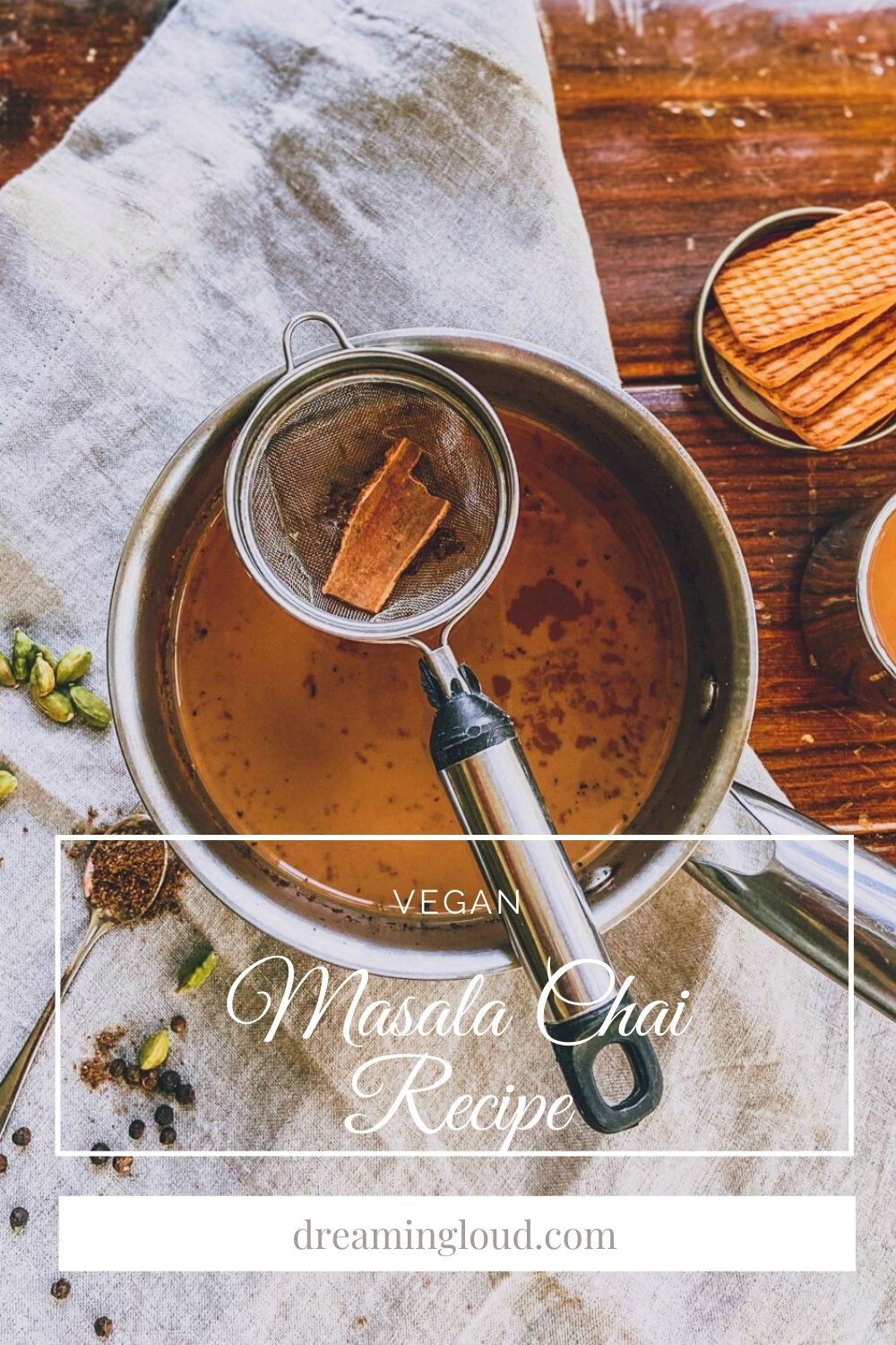 Vegan Masala Chai recipe 6 | Masala Chai Recipe by popular Michigan lifestyle blog, Dreaming Loud: image of vegan masala chai, a strainer, and a dish with biscuits in it.