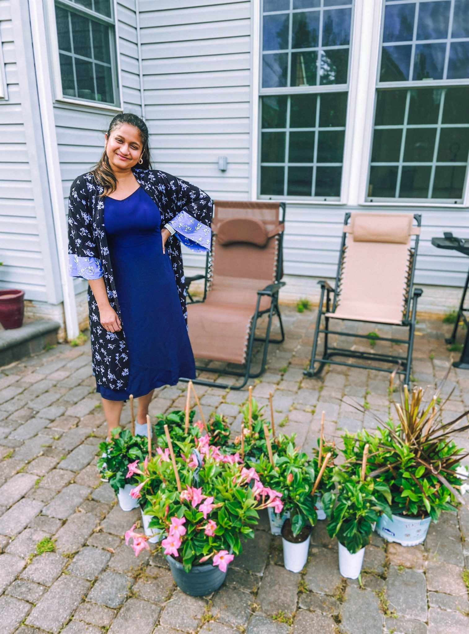 wearing Uniqlo Cami dress_ Soma COOL NIGHTS Wrap_ Marc Fisher wedges | Flower Bed Design by popular Michigan life and style blog, Dreaming Loud: image of a woman wearing a blue floral duster and blue dress and standing next to some potted plants on her back patio.