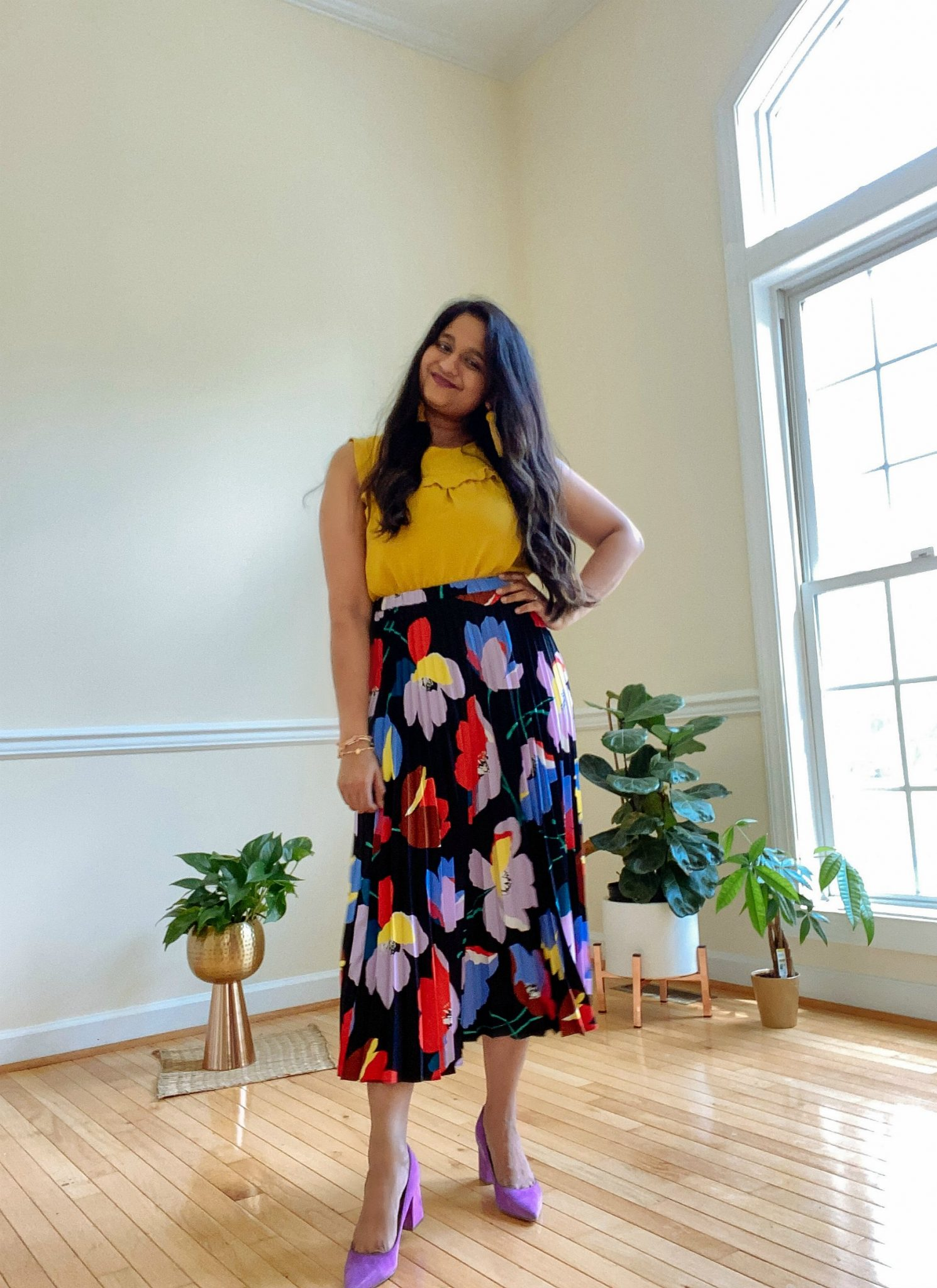 Halogen Floral pleated skirt, Loft Shell in yellow, Marc Fisher Zala pumps in purple 1 | Casual Outfits by popular Maryland lifestyle blog, Dreaming Loud: image of a woman wearing a Halogen Floral pleated skirt, Loft Shell in yellow, and Marc Fisher Zala pumps in purple.