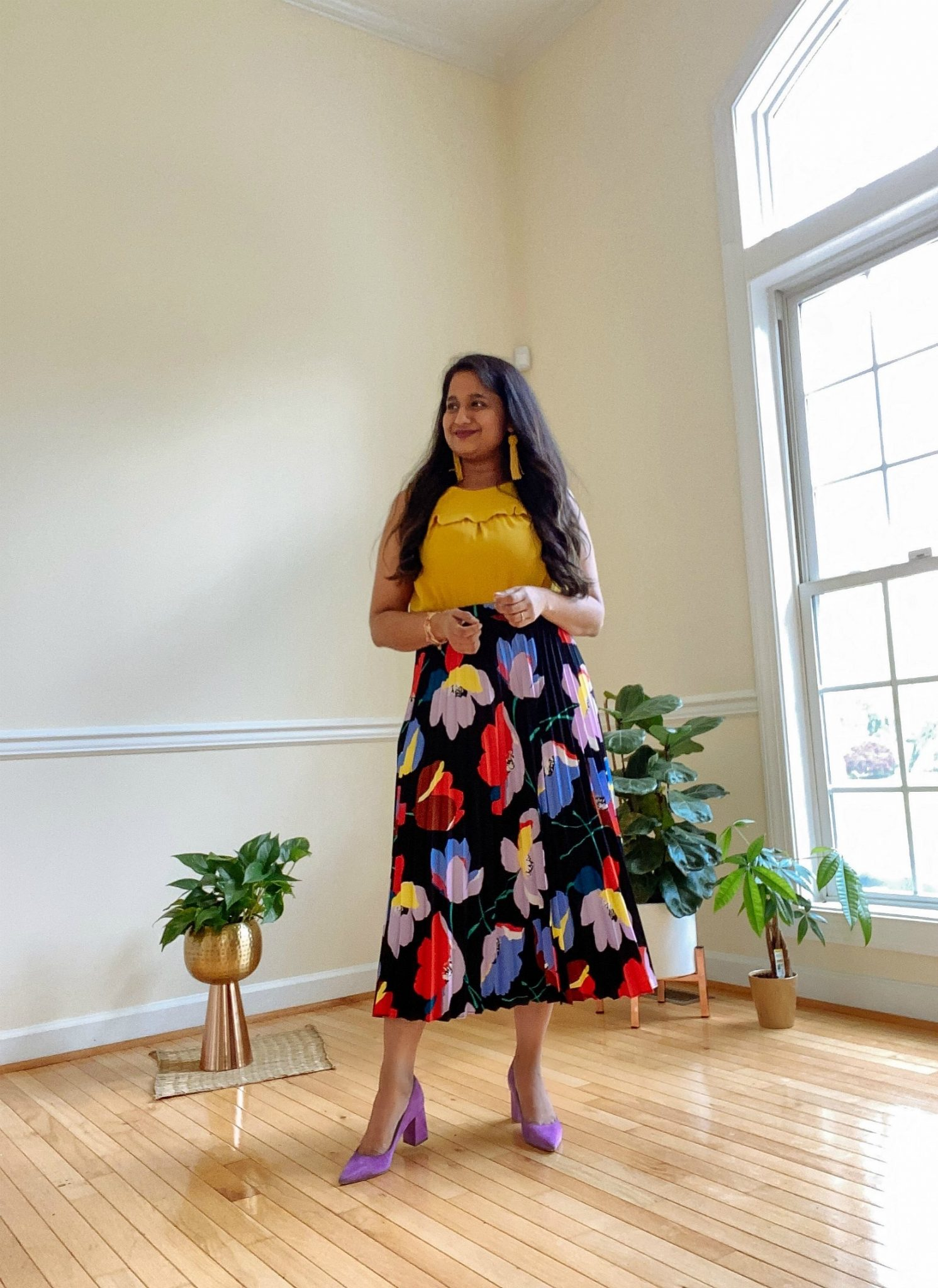 Halogen Floral pleated skirt, Loft Shell in yellow, Marc Fisher Zala pumps in purple | Casual Outfits by popular Maryland lifestyle blog, Dreaming Loud: image of a woman wearing a Halogen Floral pleated skirt, Loft Shell in yellow, and Marc Fisher Zala pumps in purple.