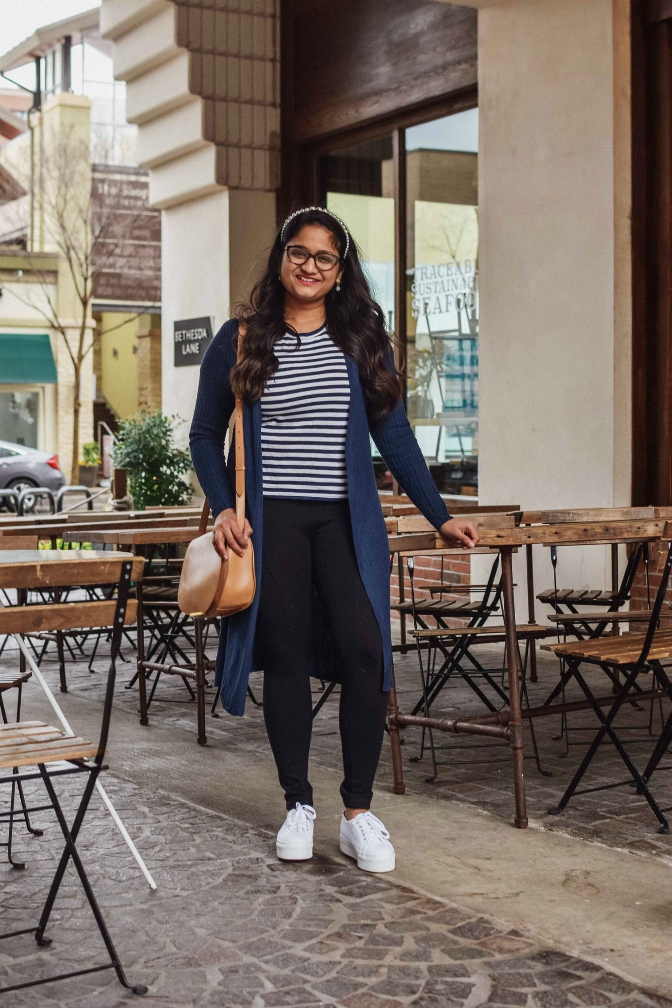 10 Winter Essentials For a Cozy Look featured by top Maryland modest fashion blogger, Dreaming Loud: image of a woman wearing Lou and Grey Travel Ponte Pocket Leggings, Everlane striped tee, INC Ribbed Duster Cardigan,Chuck Taylor All Star Ox Platform Sneake, Cuyana saddle bag