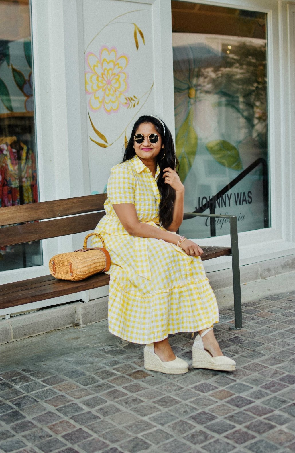 Wearing Wearing Lisa Marie Fernandez for Target Gingham Puff Sleeve Shirtdress, Castaner Carina Wedges in Cream, J.McLaughlin Ava wicker bag, pearl Headband 6 | Lisa Marie Fernandez by popular Maryland fashion blog, Dreaming Loud: image of a woman a Target Lisa Marie Fernandez yellow gingham dress, Castañer cream Carina 80 ankle tie wedge sandals, Amazon LXBSIYI Huge Gold Hoop Earrings, Olive and Piper Madison Pearl Headband, and holding a J. McLaughlin Skip to the end of the images gallery Skip to the beginning of the images gallery Ava Wicker Bag.