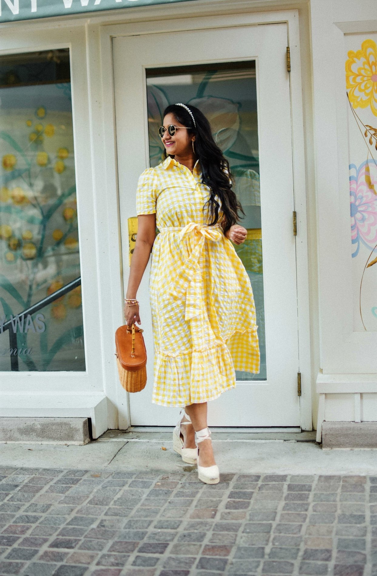 Wearing Wearing Lisa Marie Fernandez for Target Gingham Puff Sleeve Shirtdress, Castaner Carina Wedges in Cream, J.McLaughlin Ava wicker bag, pearl Headband1 | Lisa Marie Fernandez by popular Maryland fashion blog, Dreaming Loud: image of a woman a Target Lisa Marie Fernandez yellow gingham dress, Castañer cream Carina 80 ankle tie wedge sandals, Amazon LXBSIYI Huge Gold Hoop Earrings, Olive and Piper Madison Pearl Headband, and holding a J. McLaughlin Skip to the end of the images gallery Skip to the beginning of the images gallery Ava Wicker Bag.