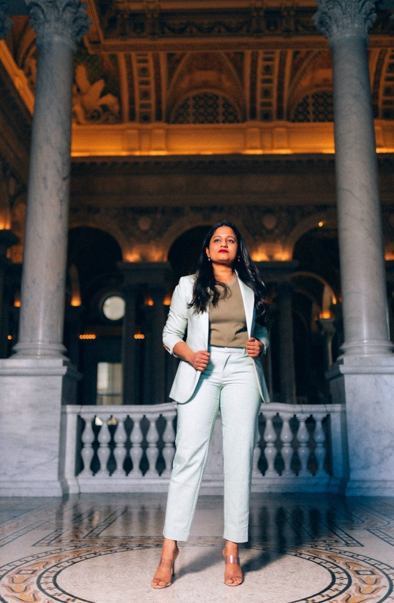 Top 5 Influencer Tips to Grow your Community featured by top US influencer and blogger, Dreaming Loud: image of a woman Wearing target A new day Mint suit set, Schutz Ariella transparent heels.