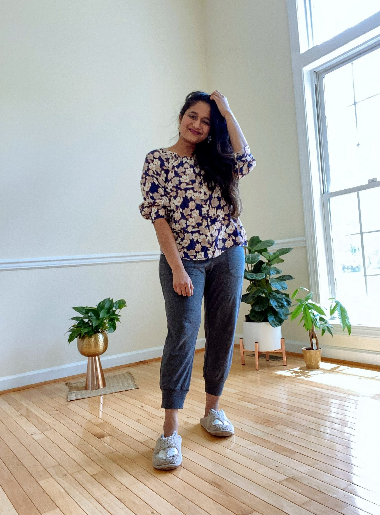 wearing Sactuary Enchanted Floral Blouse, Amazon Essentials Women's Studio Terry Capri Jogger Pant | Casual Outfits by popular Maryland lifestyle blog, Dreaming Loud: image of a woman wearing a Sactuary Enchanted Floral Blouse, and Amazon Essentials Women's Studio Terry Capri Jogger Pant.