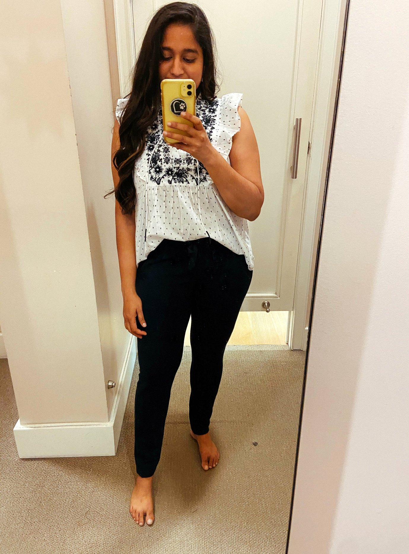 Fall WFH Outfit ideas- Wearing Embroidered Floral Dot Ruffle Shell,Pull On Slim Ankle Pants in olive 1 | Fall Clothing by popular Maryland modest fashion blog, Dreaming Loud: image of a woman wearing a Loft Embroidered Floral Dot Ruffle Shell and Loft Pull On Slim Ankle Pants.