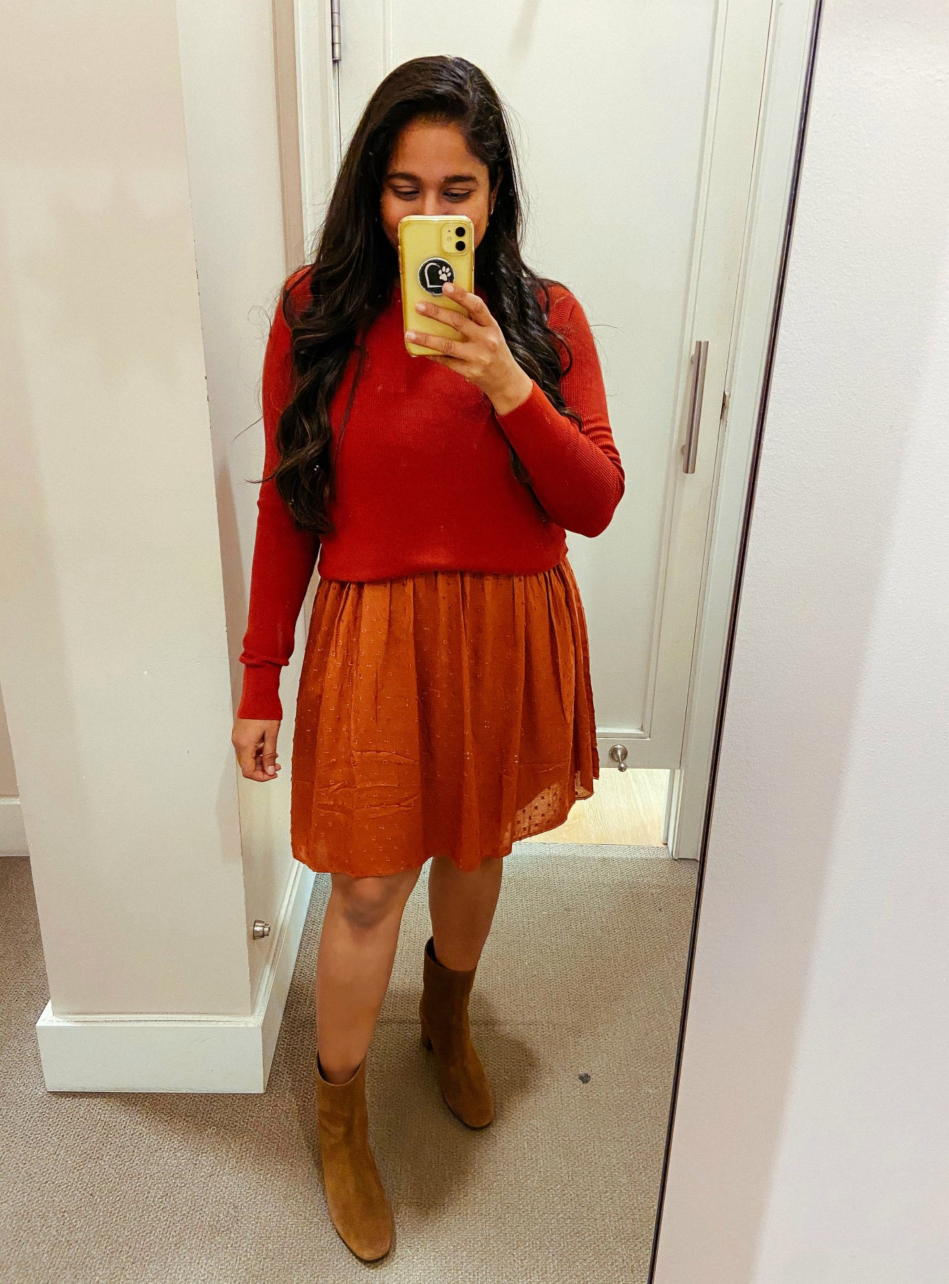 Fall fashion WFH essentials from Loft-wearing Loft Clip Strappy Swing Dress, Crew Neck Sweater in clay, J.crew Suede ankle Boots | Fall Clothing by popular Maryland modest fashion blog, Dreaming Loud: image of a woman wearing a Loft Clip Strappy Swing Dress, Crew Neck Sweater in clay, and J.crew Suede ankle Boots.
