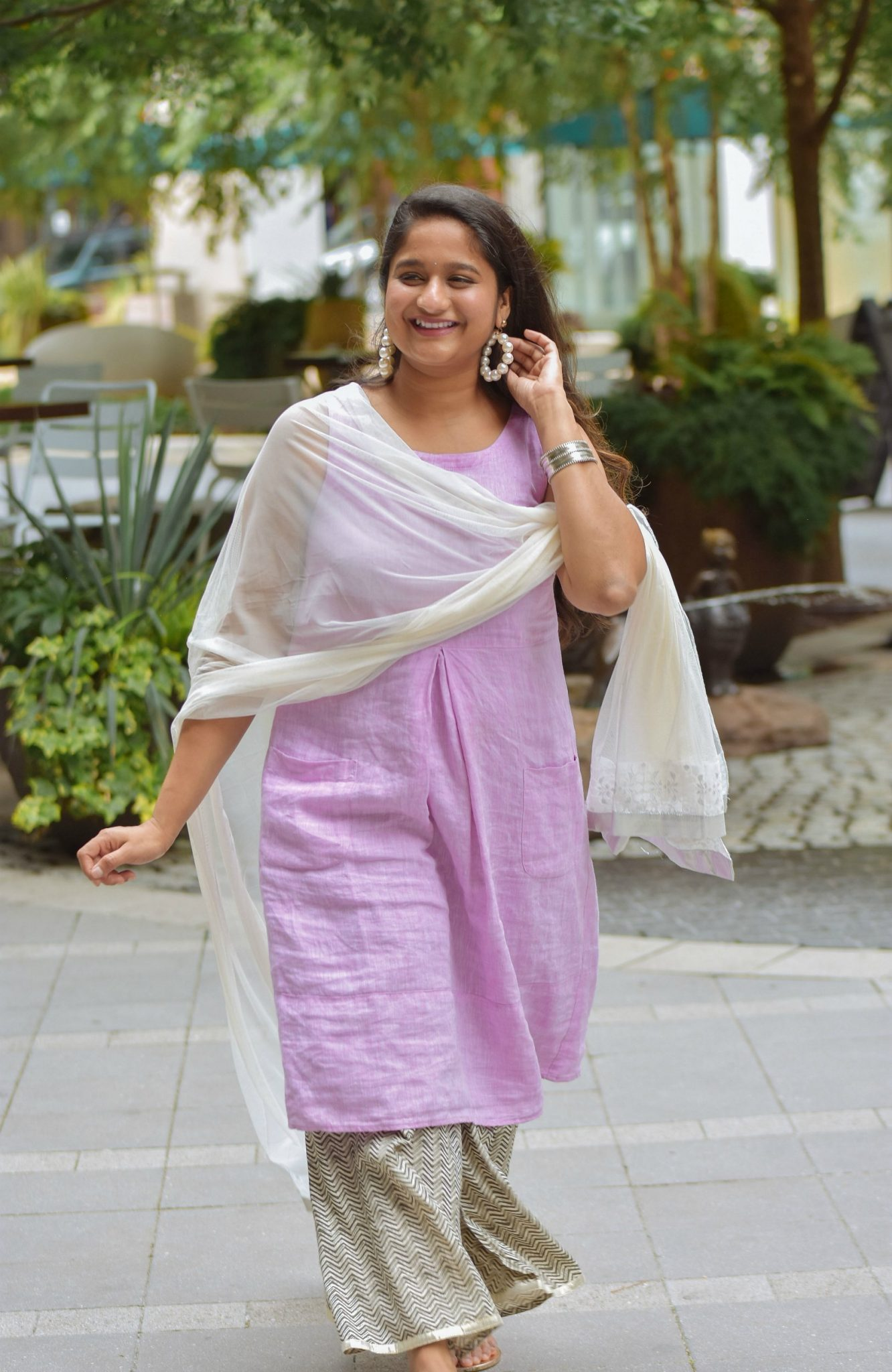 Indo-western outfits with Linen dress, desi outfits with western pieces | Indo Western by popular Maryland modest fashion blog, Dreaming Loud: image of a woman wearing an Indo Wester outfit with a purple linen dress, culottes, sliver sandals, pearl hoop earrings, and a silk dupatta.