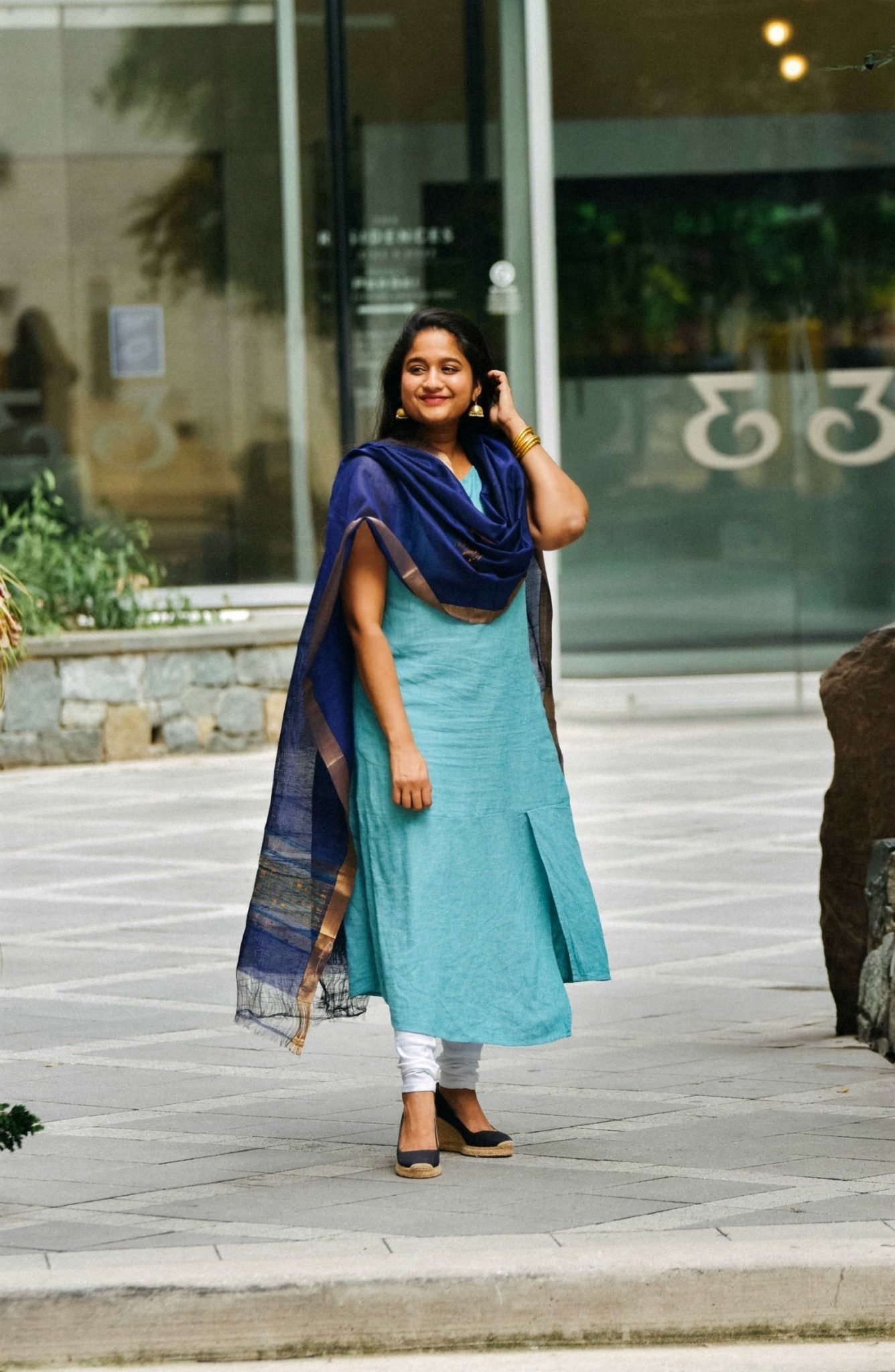 Indo-western outfit with linen dress-Wearing J.Jill Linen & Rayon Asymmetric Dress, white cotton Chudidar pant, Royal blue silk dupatta 11 | Indo Western by popular Maryland modest fashion blog, Dreaming Loud: image of a woman wearing an Indo Wester outfit with a chudidar, blue silk dupatta, blue linen dress, and gold jhumkas.