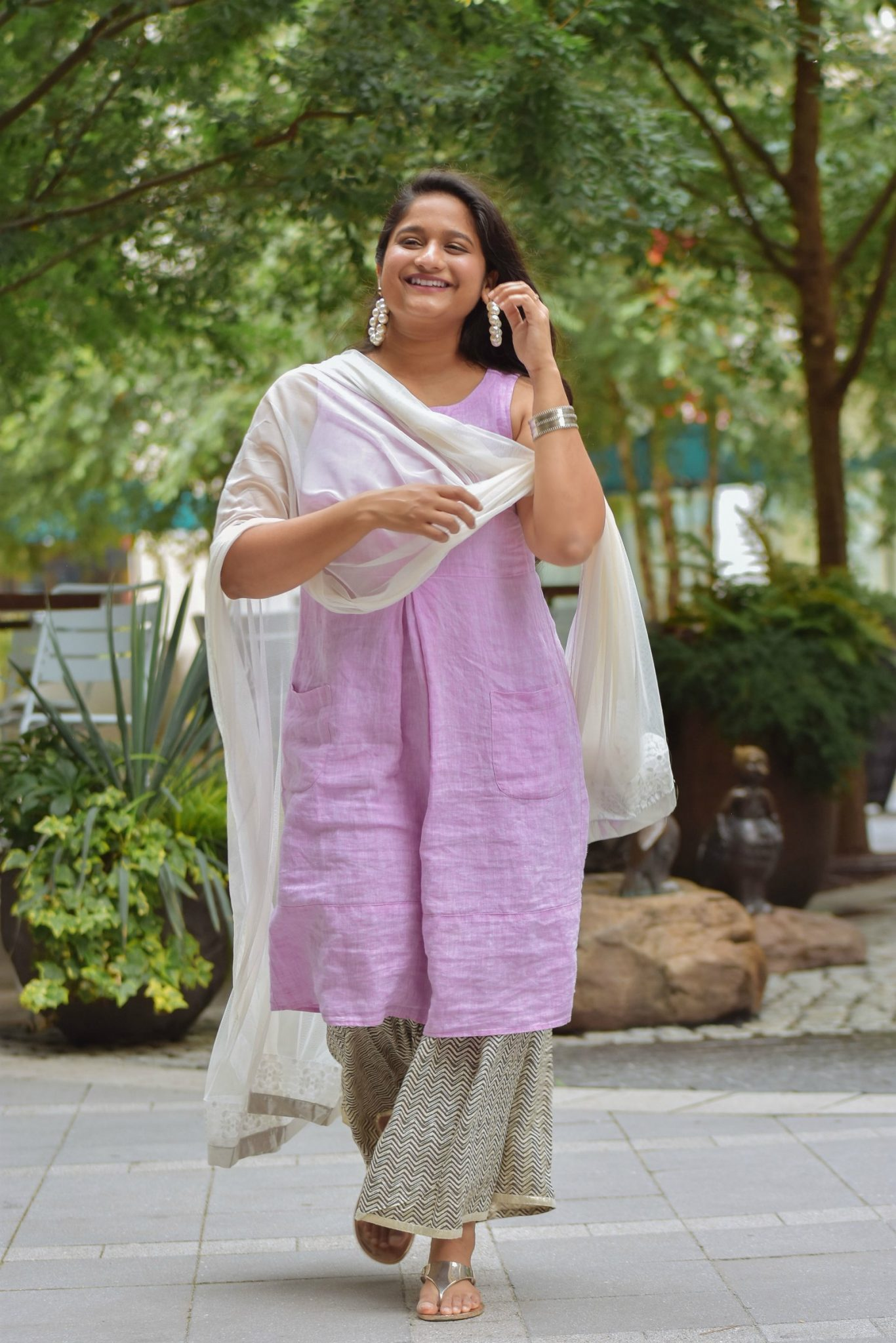 Wearing J.Jill Pleated Knit A-Line Dress, Wide leg pant, Pearl large hoops, White dupatta 6 | Indo Western by popular Maryland modest fashion blog, Dreaming Loud: image of a woman wearing an Indo Wester outfit with a purple linen dress, culottes, sliver sandals, pearl hoop earrings, and a silk dupatta.