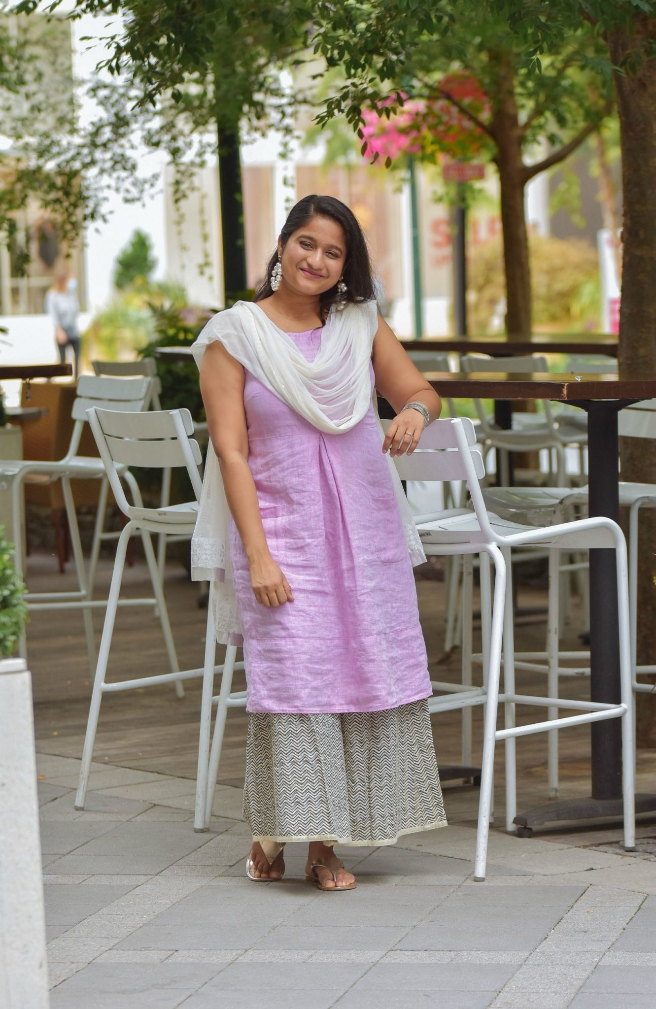 Wearing J.Jill Pleated Knit A-Line Dress, Wide leg pant, Pearl large hoops, White dupatta | Indo Western by popular Maryland modest fashion blog, Dreaming Loud: image of a woman wearing an Indo Wester outfit with a purple linen dress, culottes, sliver sandals, pearl hoop earrings, and a silk dupatta.