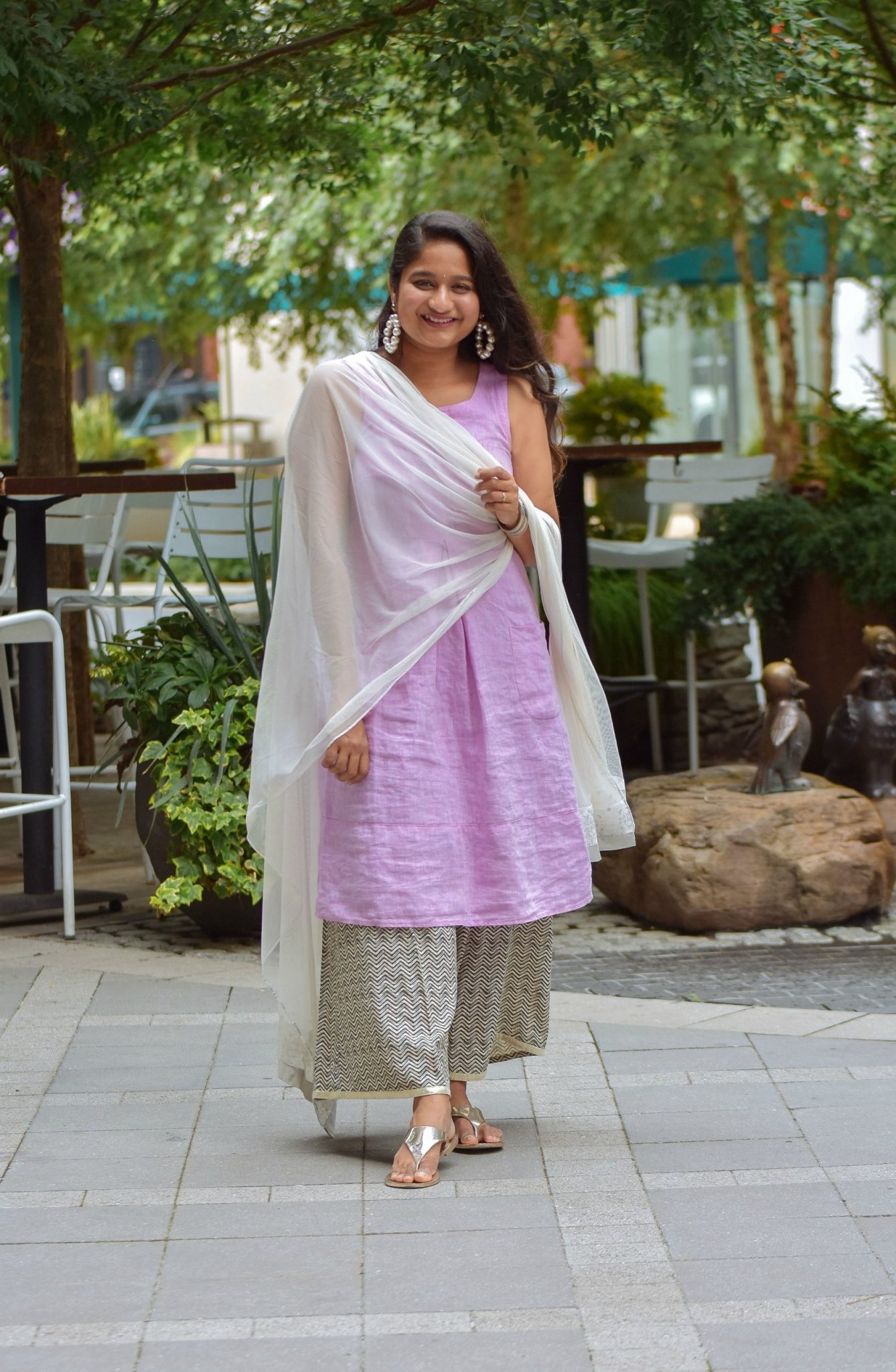 Wearing J.Jill Pleated Knit A-Line Dress, Wide leg pant, Pearl large hoops, White dupatta2 | Indo Western by popular Maryland modest fashion blog, Dreaming Loud: image of a woman wearing an Indo Wester outfit with a purple linen dress, culottes, sliver sandals, pearl hoop earrings, and a silk dupatta.