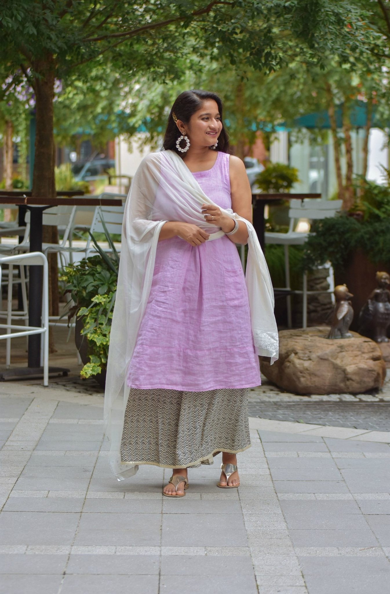 Wearing J.Jill Pleated Knit A-Line Dress, Wide leg pant, Pearl large hoops, White dupatta3 | Indo Western by popular Maryland modest fashion blog, Dreaming Loud: image of a woman wearing an Indo Wester outfit with a purple linen dress, culottes, sliver sandals, pearl hoop earrings, and a silk dupatta.