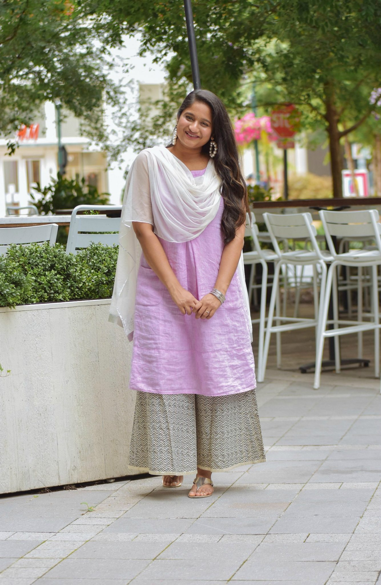 Wearing J.Jill Pleated Knit A-Line Dress, Wide leg pant, Pearl large hoops, White dupatta6 | Indo Western by popular Maryland modest fashion blog, Dreaming Loud: image of a woman wearing an Indo Wester outfit with a purple linen dress, culottes, sliver sandals, pearl hoop earrings, and a silk dupatta.