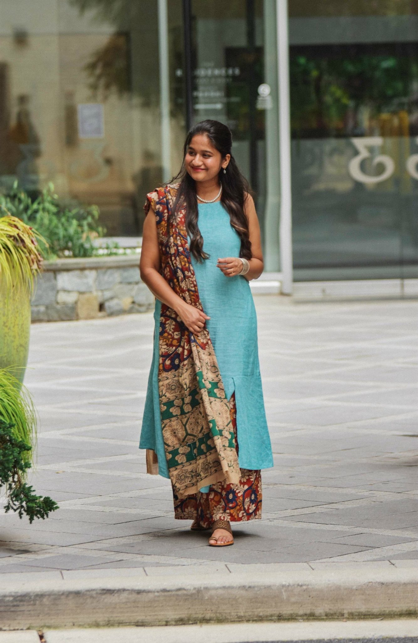 Indo western outfit with Handlooms- wearing Pure Jill Linen & Rayon Asymmetric Dress, Kalamkari Palazzo pants and Kalamkari Dupatta, J.crew factory wedges, Pearl necklace | Indo Western by popular Maryland modest fashion blog, Dreaming Loud: image of a woman wearing an Indo Wester outfit with a blue linen dress, Kalamkari handloom print pants, and Kalamkari dupatta.