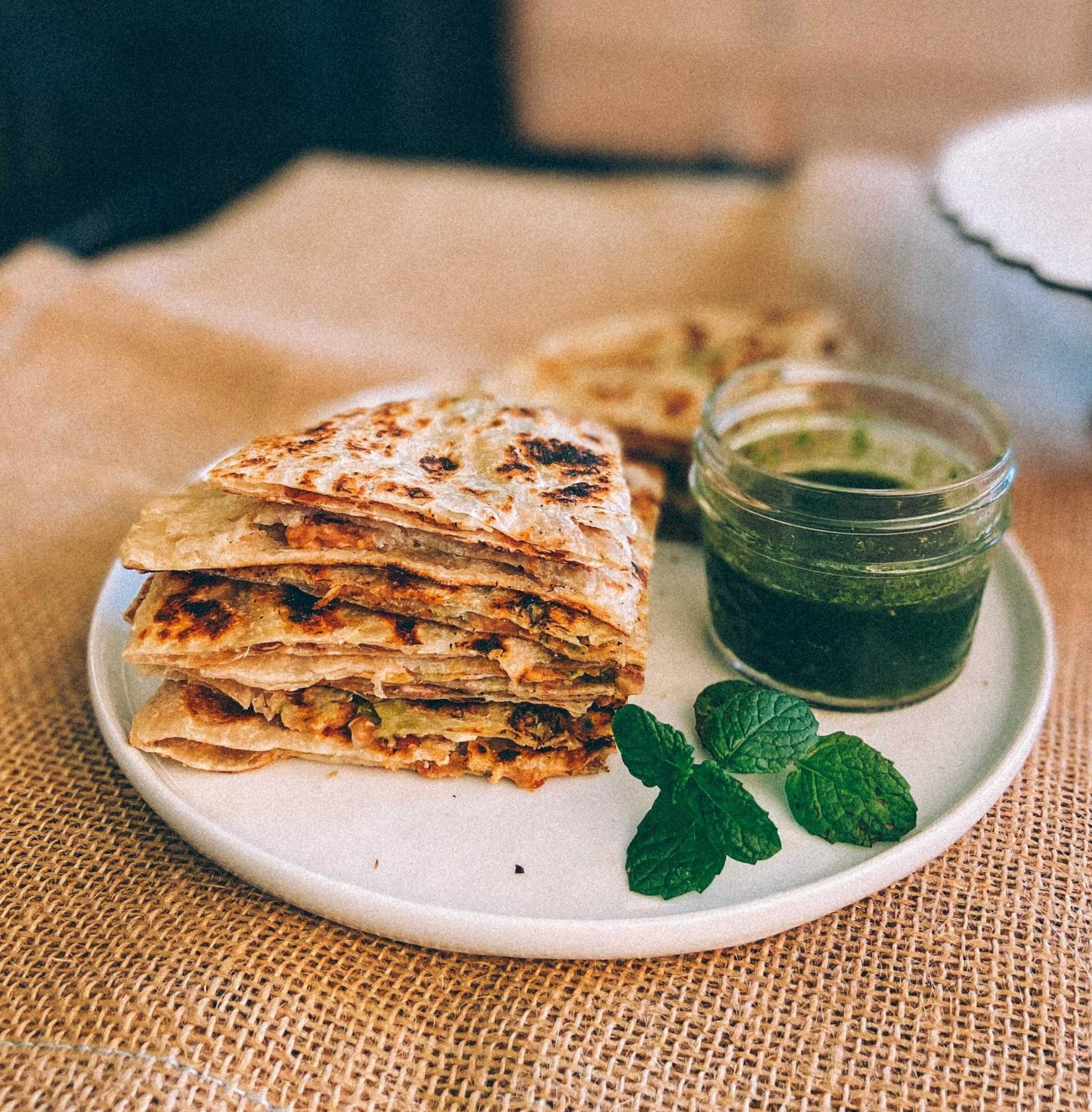 Vegan Paratha Quesadilla with Kawan low GI Parathas |Paratha Quesadilla by popular Maryland Indian food blog, Dreaming Loud: image of a plate of paratha quesadillas.