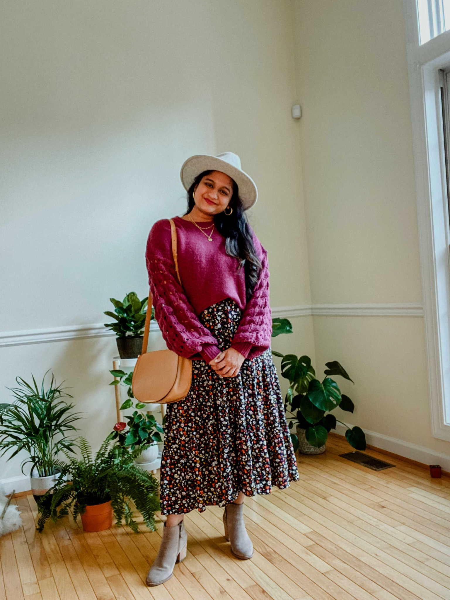Wearing Ditsy Floral Sleeveless Tiered Midi Dress, pink lily boutique purple sweater,Blondo ankle booties, lack of color grey fedora hat 1 | Summer Dresses by popular Maryland modest fashion blog, Dreaming Loud: image of a woman Wearing Ditsy Floral Sleeveless Tiered Midi Dress,pink lily boutique purple sweater,Blondo ankle booties, and lack of color grey fedora hat.