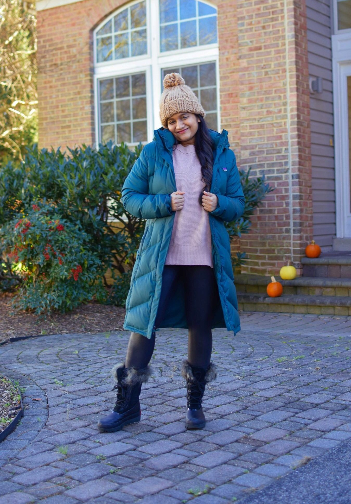 10 Winter Essentials For a Cozy Look featured by top Maryland modest fashion blogger, Dreaming Loud: image of a woman wearing Abercrombie oversized chenille sweater, Spanx faux leather legging, Sorel Joan Artic Next boots, Patagonia down it parka1-2