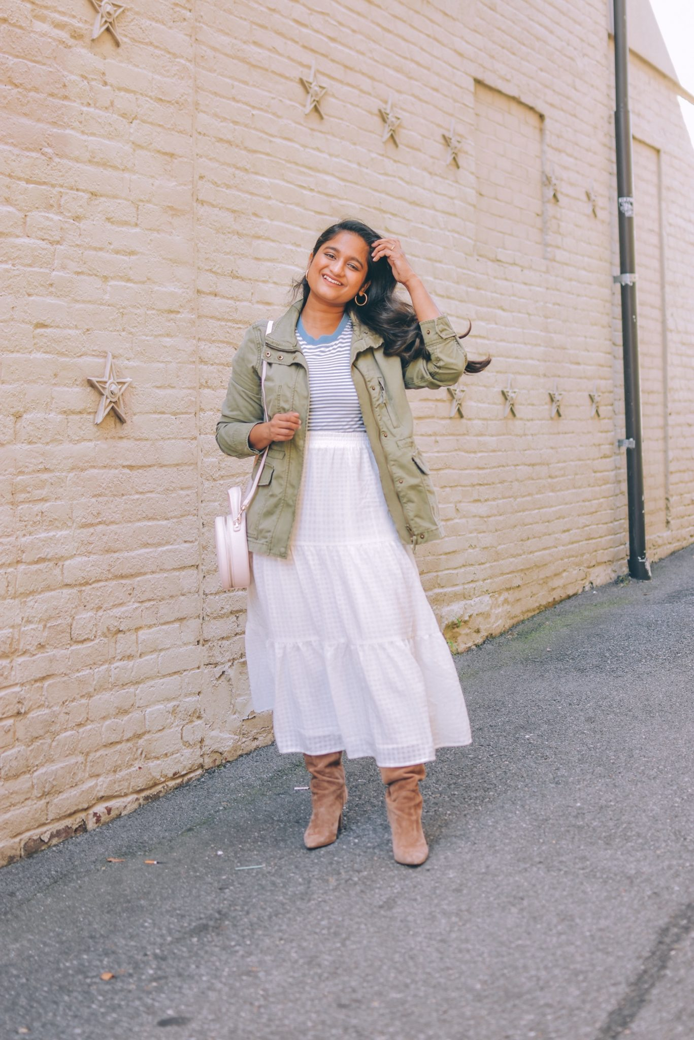 Utility Jackets by popular Maryland modest fashion blog, Dreaming Loud: image of a woman wearing a H&M white skirt, Everlane Organic Cotton Box-Cut Tee,sam Edelman boots, and Madewell Passage utility jacket