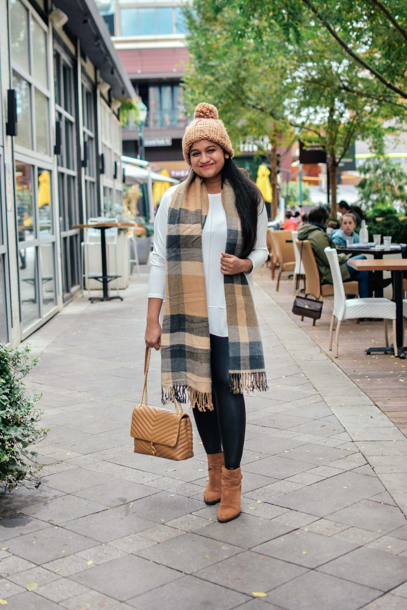 Wearing Spanx Dolman Swear, Spanx Faux leather legging, Abercrombie plaid blanket scarf, abercrombie chunky knot beanie, Naturilizer Fenya bootie 5 |Cute Thanksgiving Outfits by popular Maryland modest fashion blog, Dreaming Loud: image of a woman wearing a Spanx Dolman Swear, Spanx Faux leather legging, Abercrombie plaid blanket scarf, Abercrombie chunky knot beanie, and Naturilizer Fenya bootie.