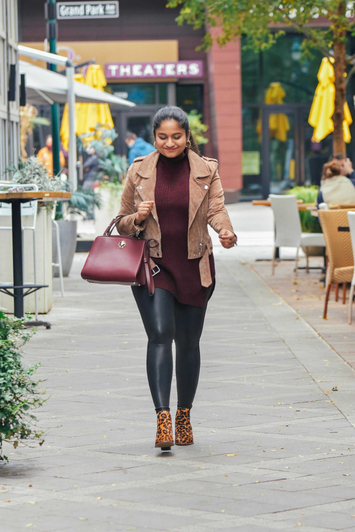 Style Spanx Faux leather legging, Blanknyc Suede moto jacket, madewell Regan Boot in Leopard-maternity style |Cute Thanksgiving Outfits by popular Maryland modest fashion blog, Dreaming Loud: image of a woman wearing Spanx Faux leather legging, Blanknyc Suede moto jacket, leopard print boots and carrying a Kate spade Romy Satchel.