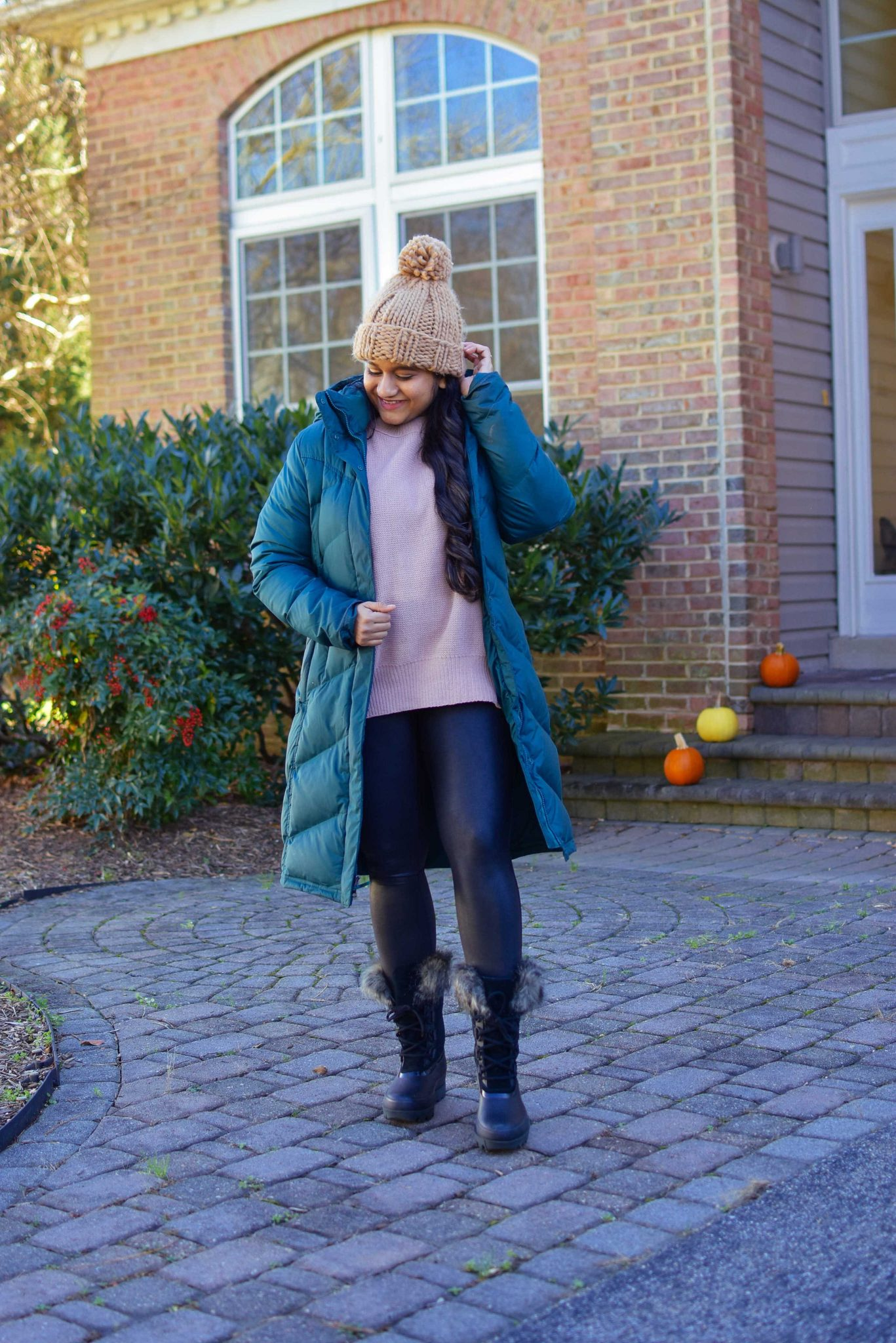 Winter Clothing by popular Maryland modest fashion blog, Dreaming Loud: image of a woman wearing Abercrombie oversized chenille sweater, Spanx faux leather legging, Sorel Joan Artic Next boots, Patagonia down it parka