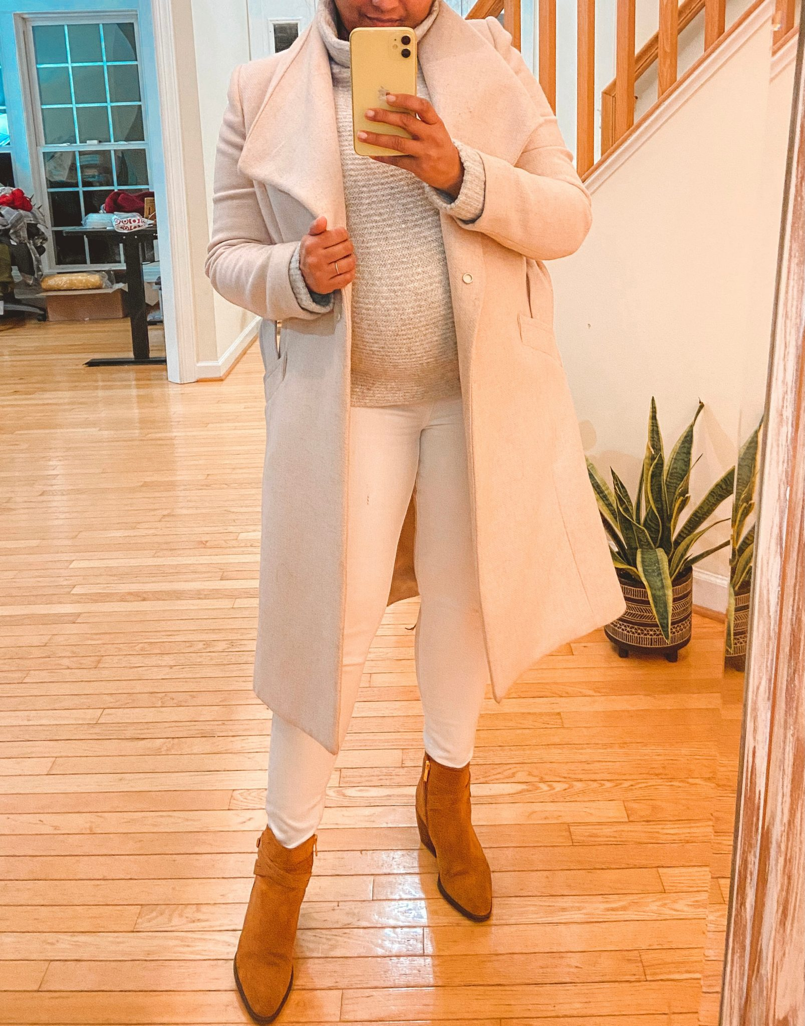 White Maternity Jeans by top Maryland modest fashion blogger, Dreaming Loud: image of a pregnant woman wearing an Amazon Daily Ritual Mock Neck Sweater, Mango Maternity high waisted jeans in white, Mango wrap coat, Naturalizer Fenya Booties