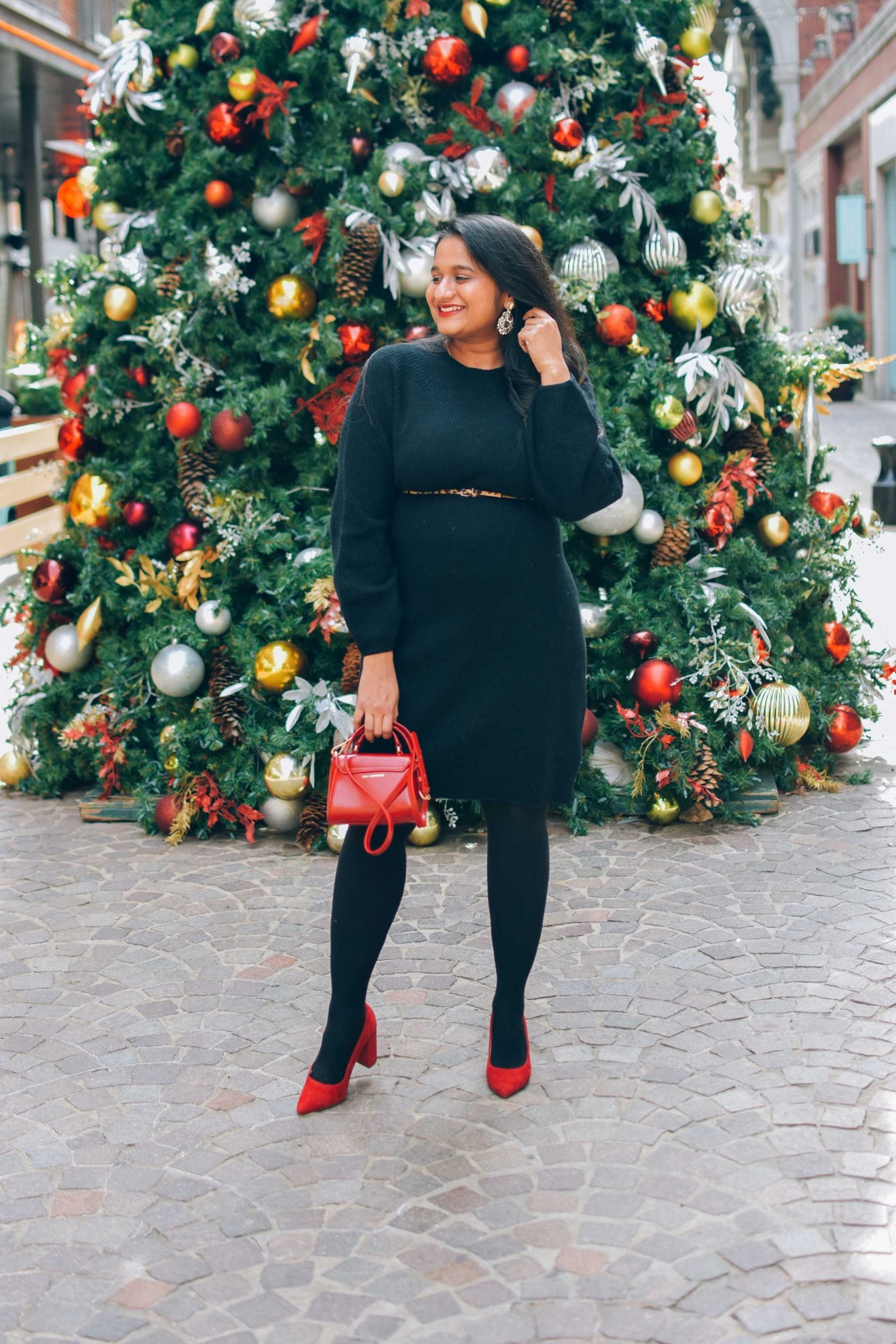 Wearing Uniqlo Baloon long sleeve sweater dress in black, Hipstick tights in black, Marc Fisher Caitlin red pumps-Holiday Outfit Ideas5 |Cute Holiday Outfit Ideas by popular Maryland modest fashion blog, Dreaming Loud: image of a woman wearing a Wearing Uniqlo ALLOON LONG-SLEEVE DRESS Sweater dress, Hipstick tights in black, Marc Fisher Caitlin red pumps, and leopard print belt.