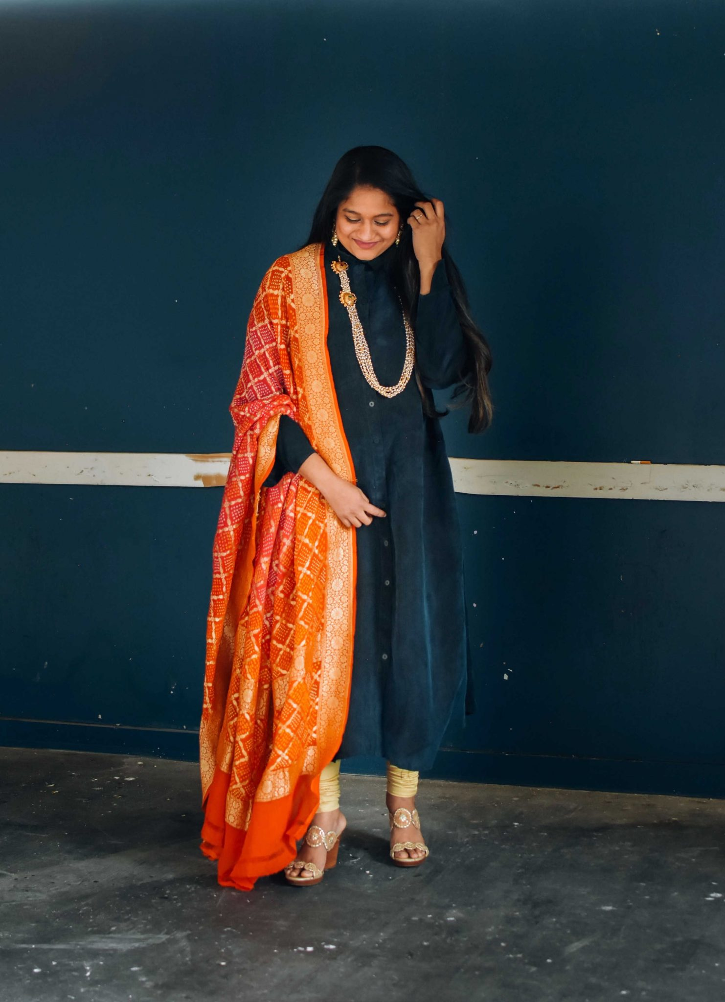 Sankranti Outfit- Wearing The Frock NYC dress, bandhani dupatta,Jack Roger Lauren Wedge Sandals, Pearl necklace- Indo western outfit ideas |Amazon Kurti Sets by popular Maryland modest fashion blog, Dreaming Loud: image of a woman wearing a Froknyc shirt dress, gold leggings, gold wedges and Keerthi statement jewelry.