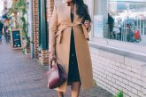 How to Use your 2021 Word of the Year to Set Goals and Intentions (Free Downloadable Goal Tracker), tips featured by top MD lifestyle blogger, Dreaming Loud: image of a pregnant woman wearing Karen Millen Investment Notch Neck Rivet Coat,Ann Taylor Button front sweater dress, Madewell Leapord print Regan booties-winter Pregnancy Outfit ideas |Word of the Year by popular Maryland lifestyle blog, Dreaming Loud: image of a woman walking down a brick sidewalk next to some buildings and wearing a camel colored tie waist wool coat, black button front dress, and leopard print ankle boots.