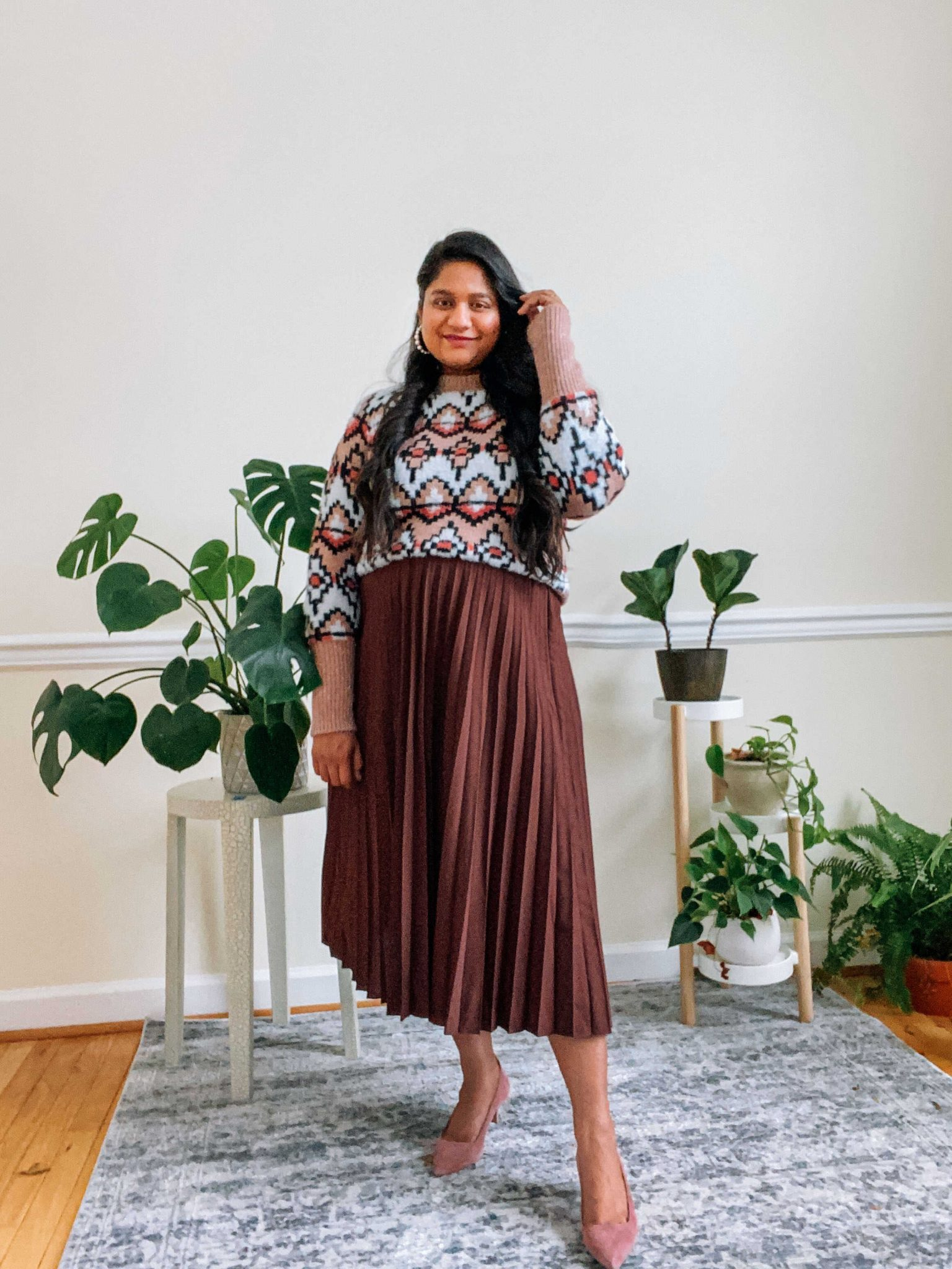 Maternity Valentines Outfits-wearing Ann Taylor Fair Isle Jacquard Sweater , Burgundy Pleated skirt, blush pink pumps |Valentine's Day Maternity Outfit by popular Maryland modest fashion blog, Dreaming Loud: image of a pregnant woman wearing a pleated skirt, sweater, and pink suede heels.