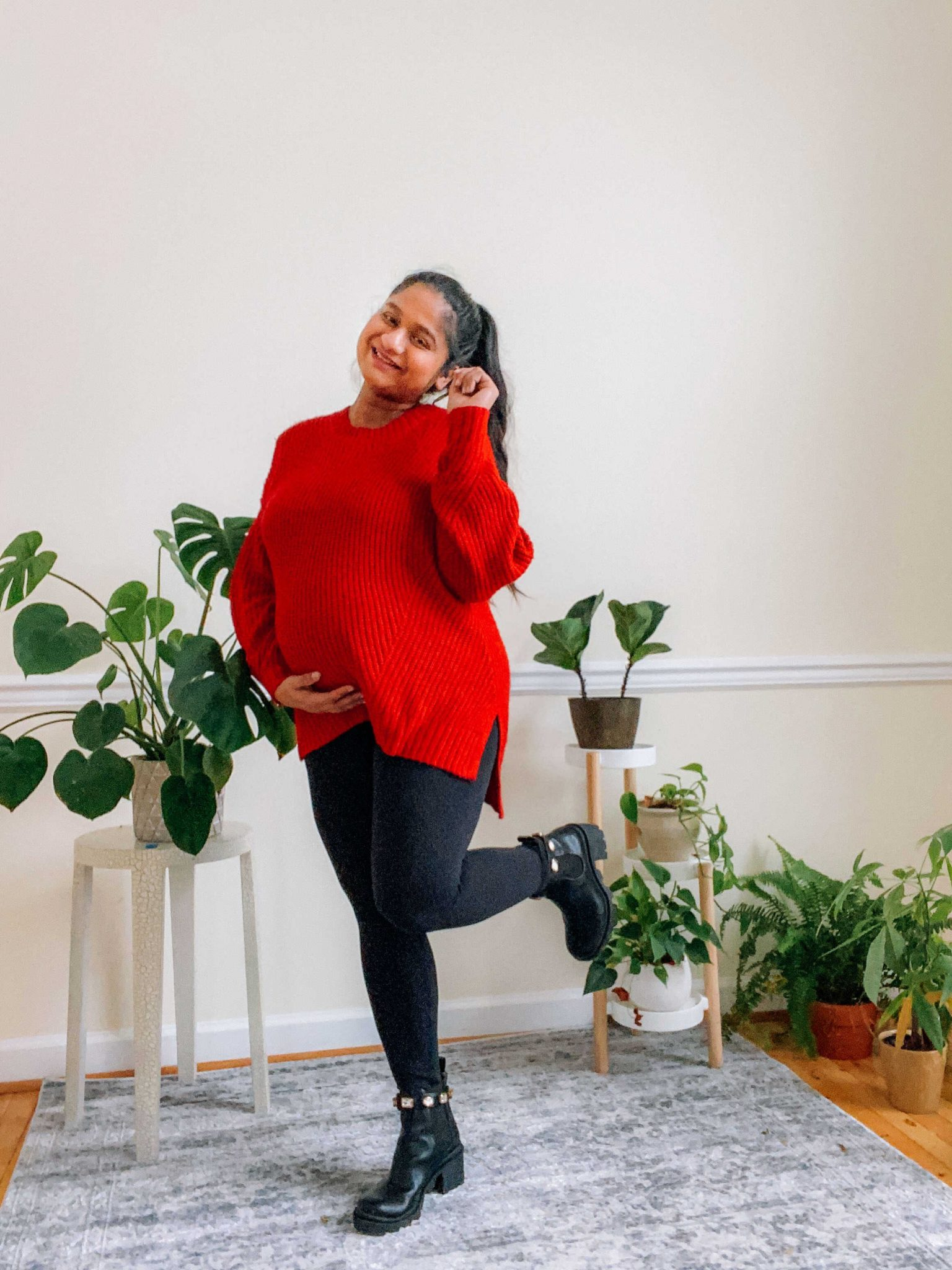 Valentines day maternity style-.wearing AE Oversized Dreamspun Crew Neck Sweater,Target Ingrid and Isabel maternity legging, Steve Madden Amulet Moto Boots |Valentine's Day Maternity Outfit by popular Maryland modest fashion blog, Dreaming Loud: image of a pregnant woman wearing a red turtleneck tunic sweater, black leggings, and black Steve Madden ankle boots.