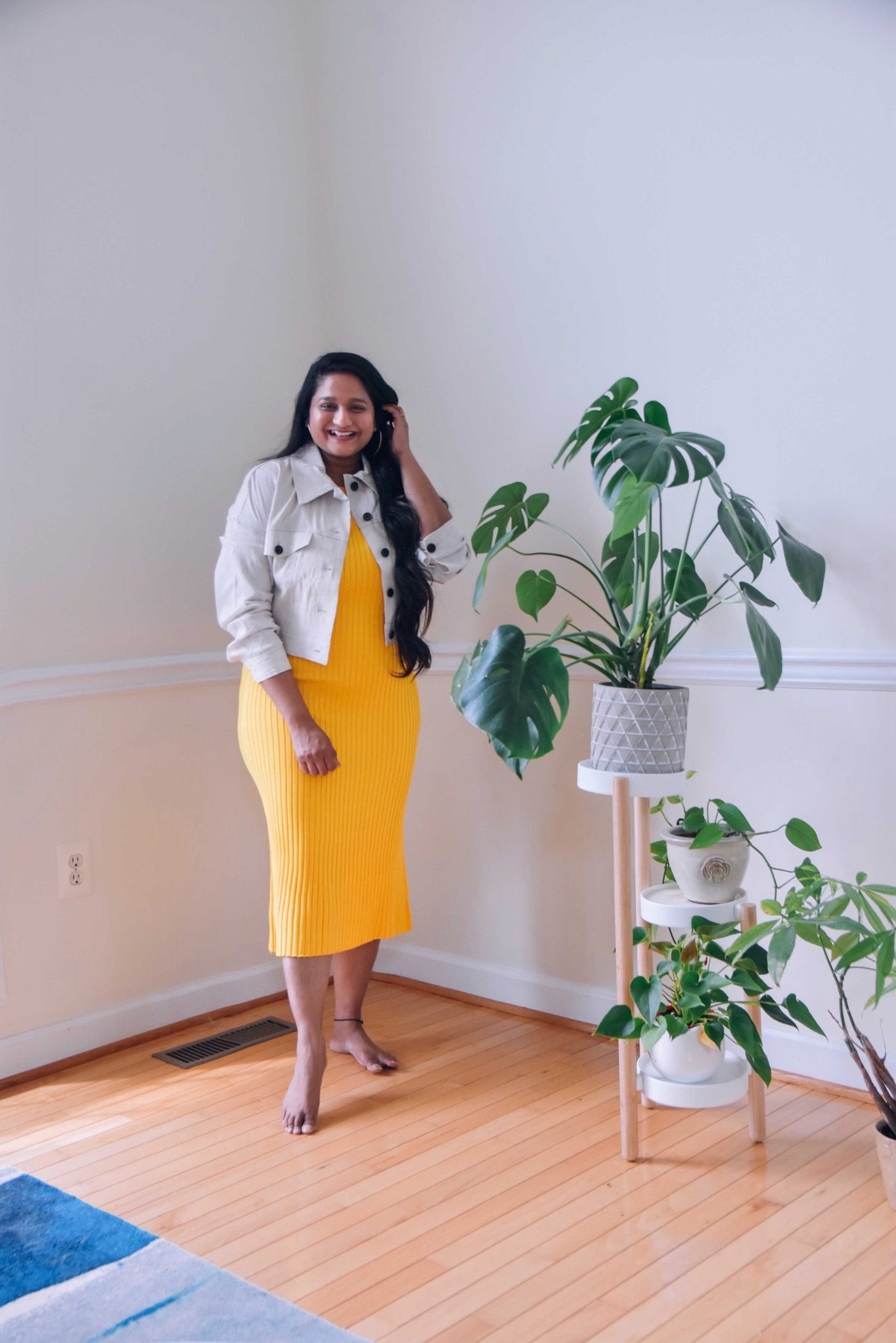 wearing MM LAFEUR The Dylan Dress—Slinky Knit dress in yellow,The Anna Jacket—Subbed Stretch Linen jacket1 | Yellow Knit Dress by popular Maryland modest fashion blog, Dreaming Loud: image of a woman wearing a yellow knit dress with a white denim jacket.