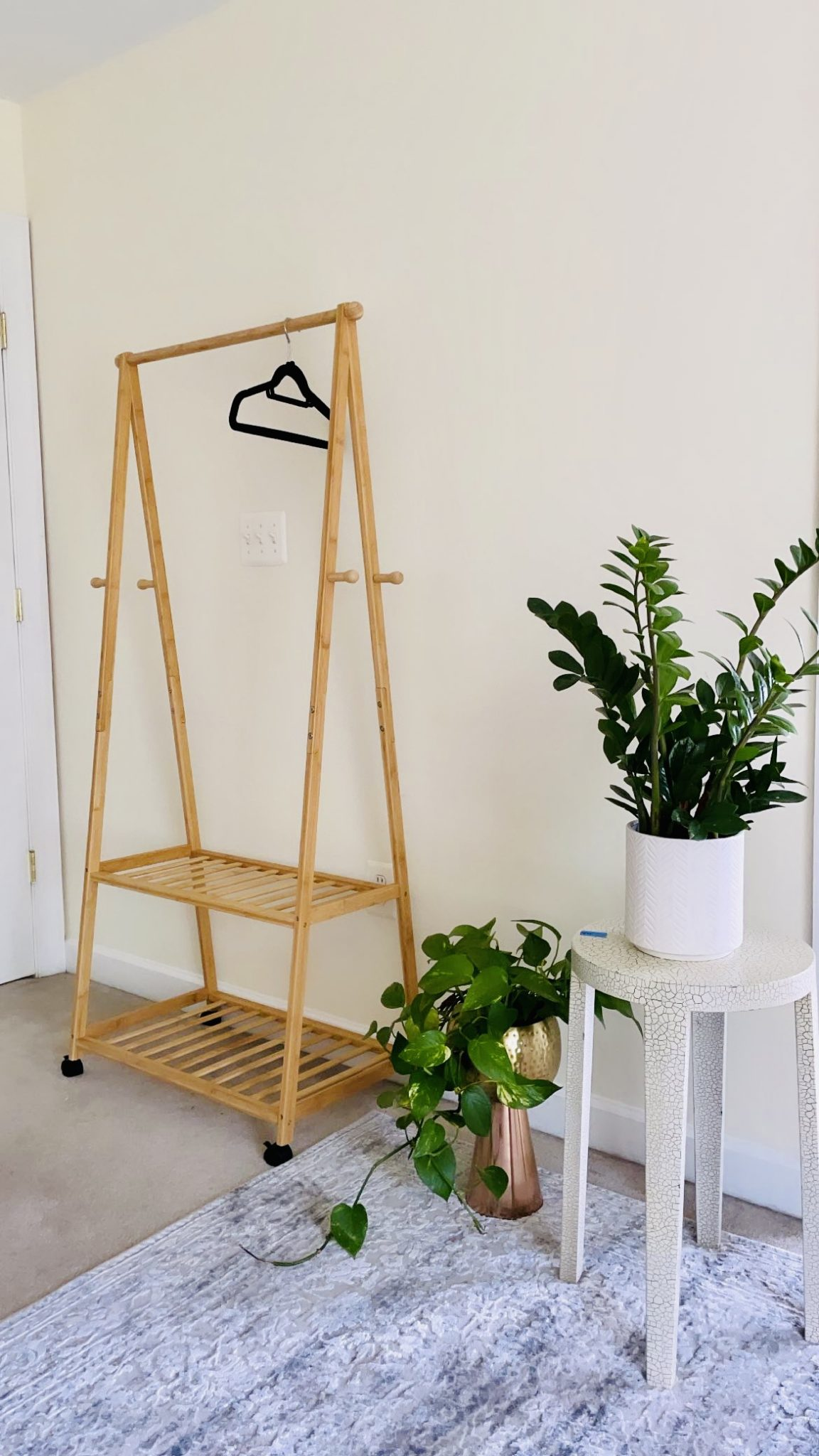 Bamboo Rolling Clothing Rack | Bamboo Clothing Rack by Maryland life and style blog, Dreaming Loud: image of a bamboo clothing rack next to some potted house plants.
