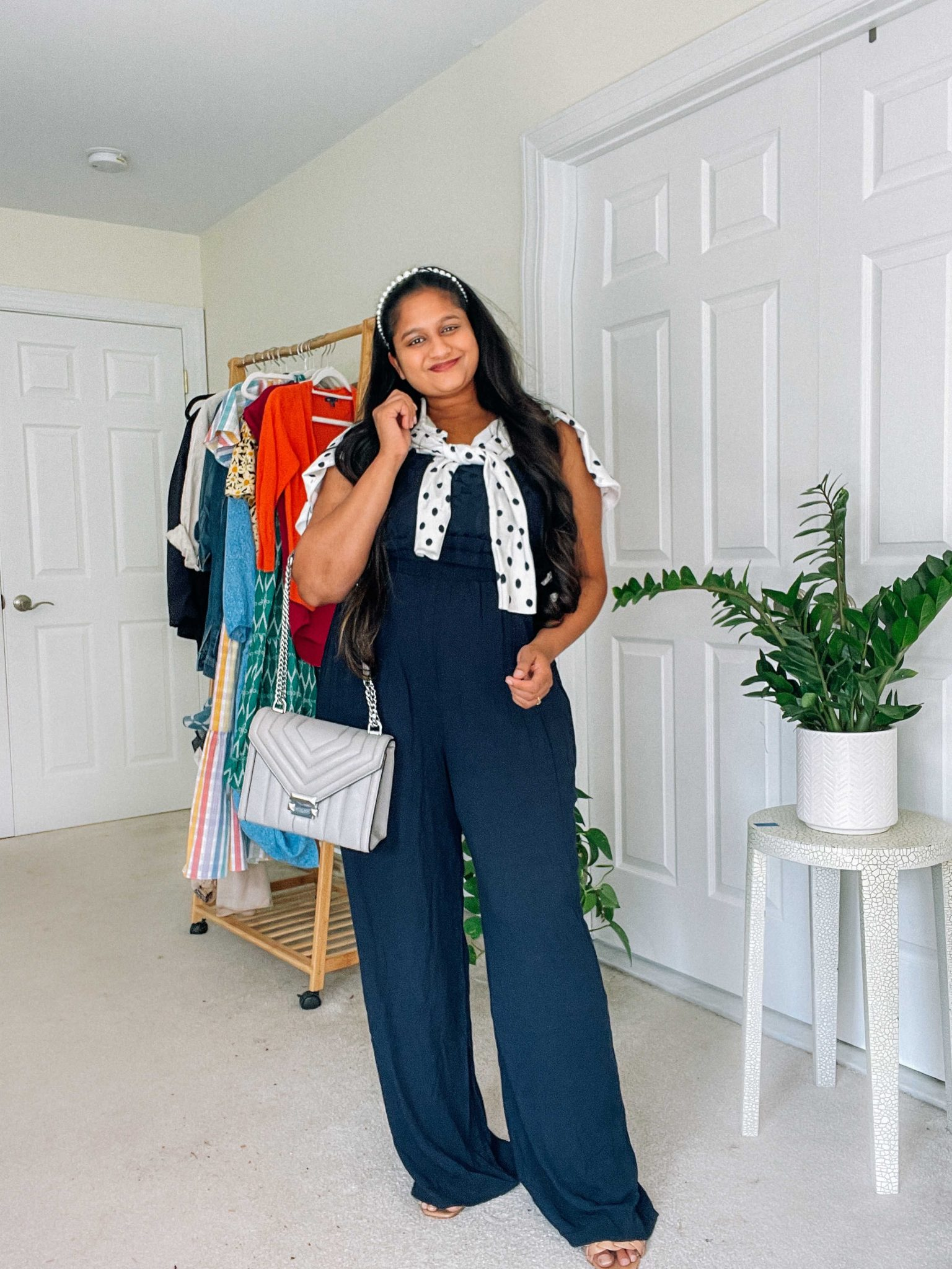 sweater around the shoulder style- Wearing Maurices Blue Lace Bodice Jumpsuit, Michael Kors Whitney Quilted Leather Shoulder Bag, Polka dot Cardigan by top US modest fashion blog dreaming loud