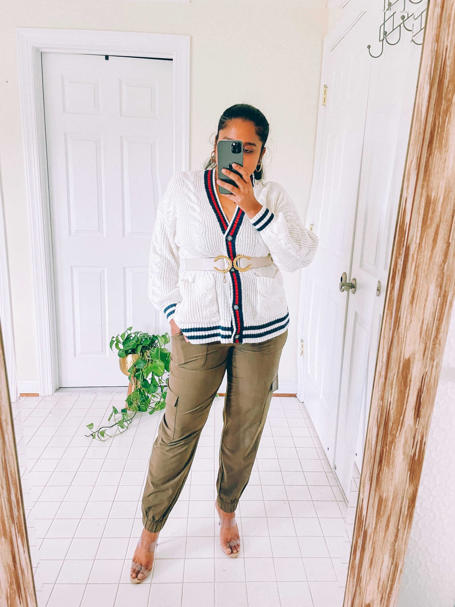 How to wear cargo joggers, tips featured by top US modest fashion blogger, Dreaming Loud: image of a woman Wearing American Eagle AE Oversized Cable Knit Button-Up Cardigan, banana Republic factory AirStretch Tie-Waist Cargo Jogger,Raina cici belt,Schutz Ariella Sandal